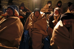 Millions in Japanese cold struggle without electricity, heat
